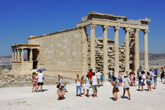 Tourist visit ruins on Acropole in Greece. Royalty Free Stock Image