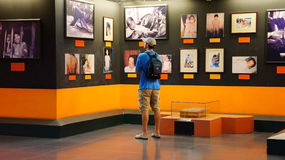 Tourist visit Vietnam War Remnant Museum. HO CHI MINH , VIETNAM- AUG 12 : Tourist visit Vietnam War Remnant Museum, people looking photo of agent orange victim Stock Image