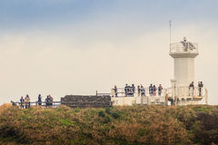 The tourist visited Lighthouse, the target of treking in Seopjikoji. Stock Image