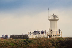 The tourist visited Lighthouse, the target of treking in Seopjikoji. Royalty Free Stock Photography