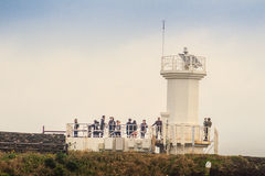 The tourist visited Lighthouse, the target of treking in Seopjikoji. Stock Photography