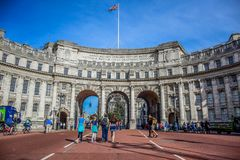 Tourist visiting Admiralty Arch at the end of The Mall, London, UK royalty free stock photo