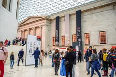 Tourist visiting the British Museum in Bloomsbury, London, United Kingdom. Tourist visiting the British Museum, a public institution dedicated to human history stock image