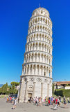 Tourist visiting famous Italian landmark Pisa towe Stock Images