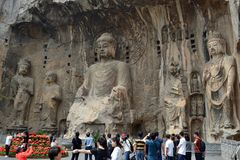 Tourist visiting Longmen Grottoes, that`s famous for its thousan. Ds of holes filled by Buddha statues. Pic was taken in September 2017 Royalty Free Stock Image