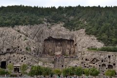Tourist visiting Longmen Grottoes, that`s famous for its thousan. Ds of holes filled by Buddha statues. Pic was taken in September 2017 Stock Photo