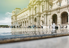 Tourist visiting Louvre, Paris sightseeing Stock Photography