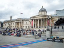 Tourist visiting the National Gallery with Trafalgar Square in foreground, London, England stock photo