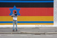 Tourist visiting the new designed Berlin Wall Royalty Free Stock Photos