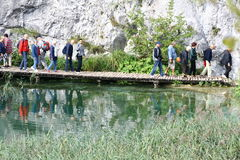 Tourist visiting Plitvice Lakes National Park Royalty Free Stock Photo