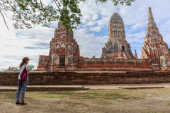 The tourist visiting ruin brick temple of Chaiwattanaram temple in Ayutthaya Historical Park, Thailand Royalty Free Stock Image