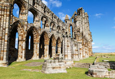 Tourist visiting the ruins of Whitby Abbey Stock Photos