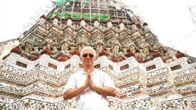 Tourist visiting Temple of Dawn or Wat Arun in Bangkok, Thailand. landmark destination stock video