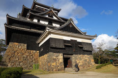 Tourist visits Matsue samurai feudal castle in Shimane prefectur Royalty Free Stock Photo