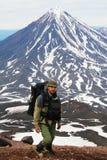 Tourist and  vulcano. The Tourist on background  vulcano Koryakskiy. Kamchatka Stock Photography