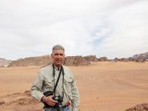 Wadi Run Desert, Jordan Travel, Tourist. Tourist in the Wadi Rum desert nature landscape in Jordan. The Middle East is a popular travel destination for tourists stock image