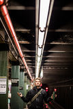 Tourist waiting the Metro under the Lights in Brooklyn, New York Stock Photos
