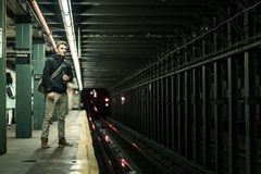 Tourist waiting the Metro under the Lights in Brooklyn, New York Royalty Free Stock Images