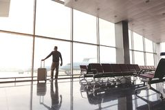 Tourist waiting for trip by plane Royalty Free Stock Photos