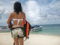 Lady backside walk on beach travel in Thailand royalty free stock photography