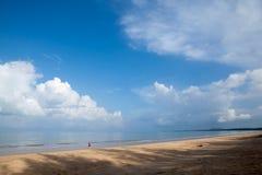 Tourist is walking along beach Stock Photos