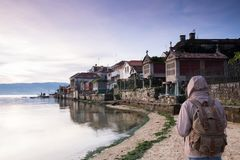 Tourist walking along the seashore in the town of Combarro. Pontevedra, Galicia, Spain Stock Photo