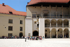 Tourist walking around Wawel royal castle Stock Photography