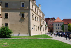 Tourist walking around Wawel royal castle Royalty Free Stock Photo