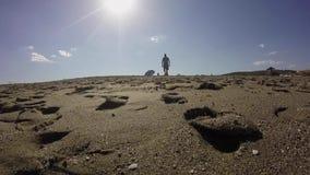 Tourist walking on the beach stock video