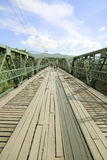 The tourist walking on the bridge in Pai district was built during World War 2 at northern of Thailand. The tourist walking on the bridge in Pai district was Royalty Free Stock Photos