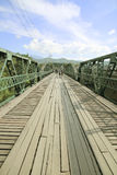 The tourist walking on the bridge in Pai district was built during World War 2 at northern of Thailand. The tourist walking on the bridge in Pai district was Stock Image