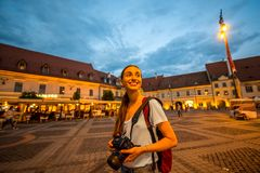 Tourist walking central square in Sibiu Stock Photography