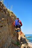 Tourist walking on cliff Stock Image