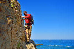Tourist walking on the cliff Stock Photos