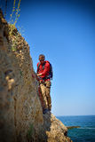 Tourist walking on the cliff Stock Images
