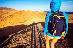 Tourist walking deserted landscape on Lanzarote island Royalty Free Stock Image