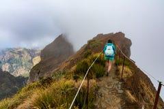 Tourist walking on the edge of the ridge. royalty free stock photo