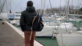 Tourist is walking on embankment of Via destra del port in Rimini stock footage