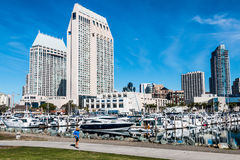 Tourist Walking at Embarcadero Marina Park North in San Diego. SAN DIEGO, CALIFORNIA - JANUARY 8, 2017: Tourist walking on pathway at Embarcadero Marina Park stock image