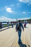Tourist walking on the footbridge in the Peter and Paul Fortress Stock Images