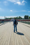 Tourist walking on the footbridge in the Peter and Paul Fortress Royalty Free Stock Photography