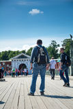 Tourist walking on the footbridge in the Peter and Paul Fortress Royalty Free Stock Images
