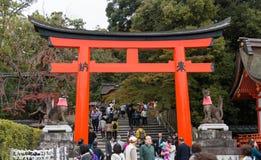 Tourist walking through giant torii gate Royalty Free Stock Photo