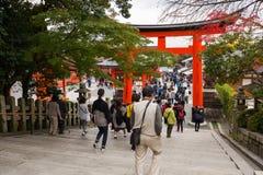 Tourist walking through giant torii gate Stock Image