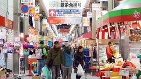 Tourist walking in Kuromon fish market Osaka, Japan Stock Photo