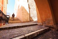 Tourist Walking Through Mediterranean Town. Tourist walking through old mediterranean town Royalty Free Stock Photos