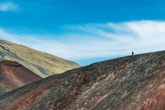 Tourist walking on Mount Etna volcano Royalty Free Stock Image