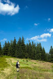 Tourist walking through mountain path Stock Image