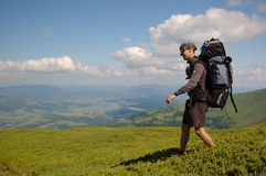 The tourist walking in the mountains Stock Photography