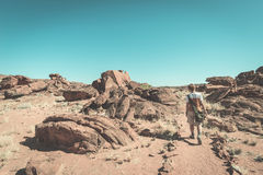 Tourist walking in the Namib desert, Namib Naukluft National Park, Namibia. Adventure and exploration in Africa. Toned image, vint Royalty Free Stock Photos
